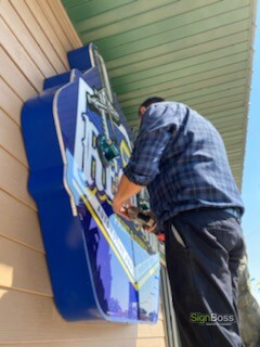 Installing the custom shaped cabinet sign
